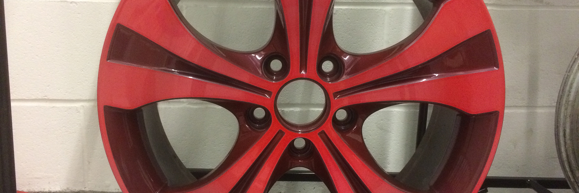 Red tinted alloy wheel with Tintrite from Ayce Systems