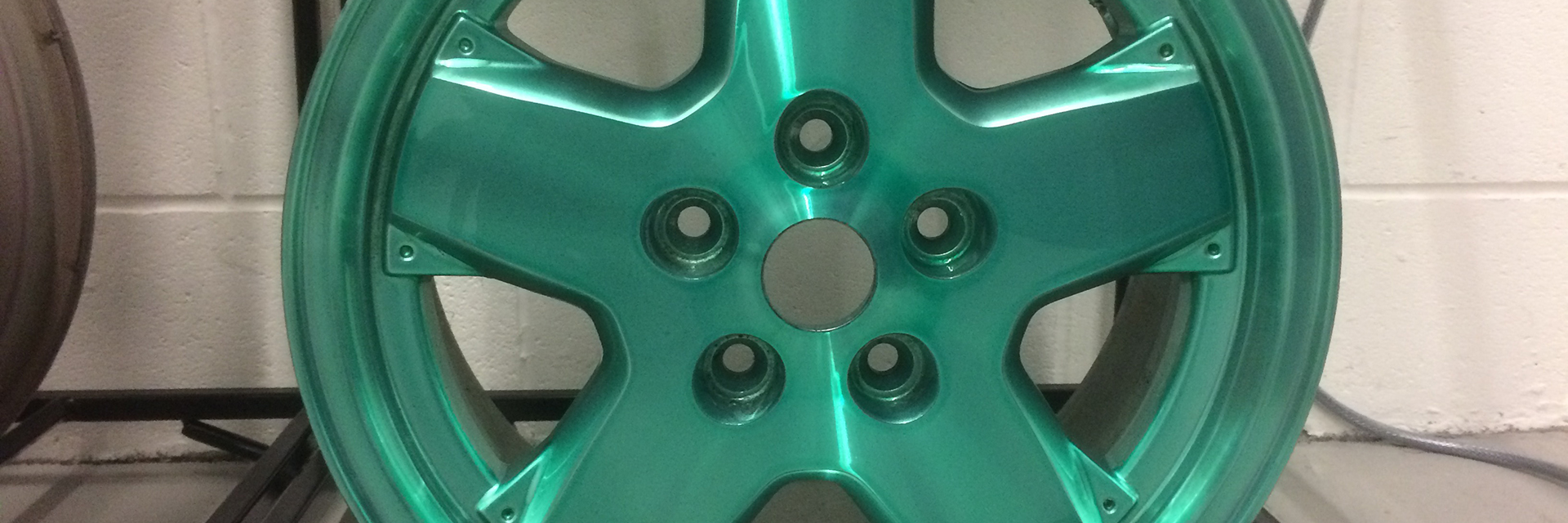Green tinted alloy wheel with Ayce Systems Tintrite Kit